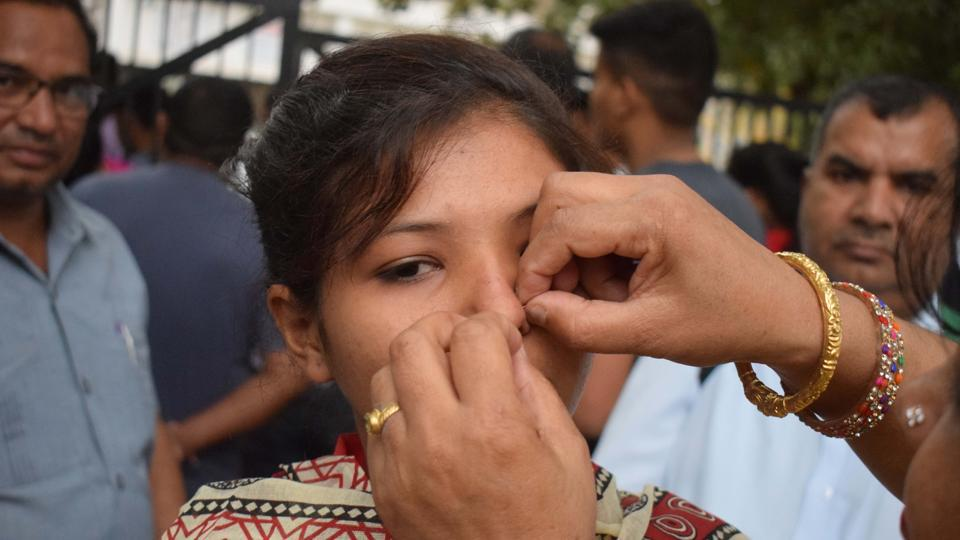 A parent removes the nose pin of a student at the Government Model Senior Secondary School exam centre in Sector 23, Chandigarh. (Sikander Singh Chopra/HT Photo)